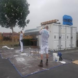 painting contractor Claremont before and after photo 1563211729539_Men_Carrying_Tube